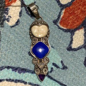 Jewelry - Beautiful genuine silver caved moon face pendant
